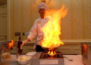 Chef with flaming dish