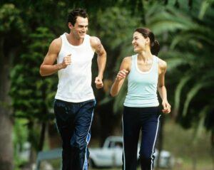 Sexy couple jogging after losing weight